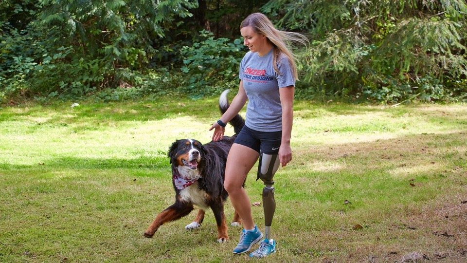 A woman who lost her leg in a boating accident uses h the Genium prosthetic leg.