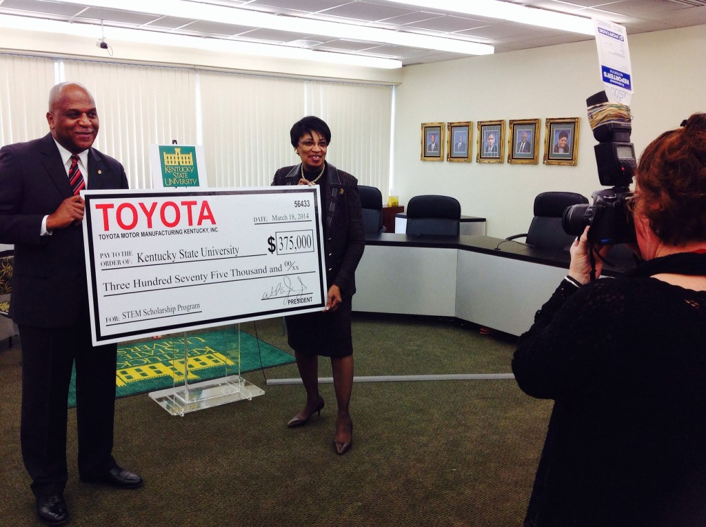 TMMK President Wil James presents a $375,000 check to Kentucky State University President Dr. Mary Evans Sias.