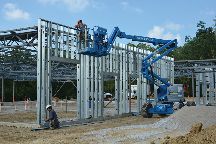 Workers with Paul Hemmer Construction erect new office space for St. Elizabeth Healthcare in Northern Kentucky in August 2013. After improving in 2013, commercial real estate activity is forecast to increase significantly in 2014 and 2015. (Paul Hemmer Construction photo)