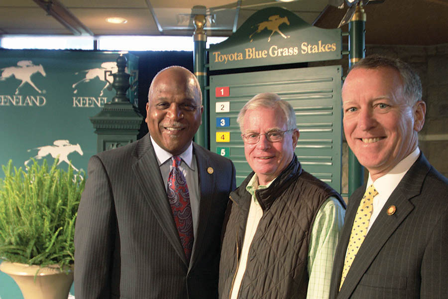 Toyota Motor Manufacturing Kentucky President Wil James visits with Dave Switzer of the Kentucky Thoroughbred Association and Bill Thomason, president of Keeneland.