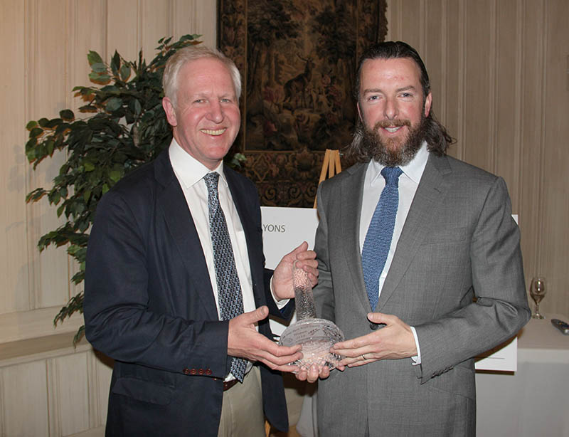 """Shane Ryan, right, presents the Dr. Tony Ryan Book Award to David Owen, author of """"Foinavon: The Story of the Grand National's Biggest Upset."""""""