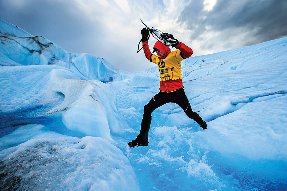 Photographer Chris Radcliffe especially loves this glacier stream leap photo because he had to leap the raging icy river himself, first, to capture the adventure race competitor behind him.