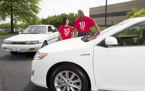 """Toyota Motor Manufacturing Kentucky (TMMK) team members check out the """"first"""" Camry built at the plant in 1988 and the 10 millionth vehicle, a Camry Hybrid, built in 2014."""