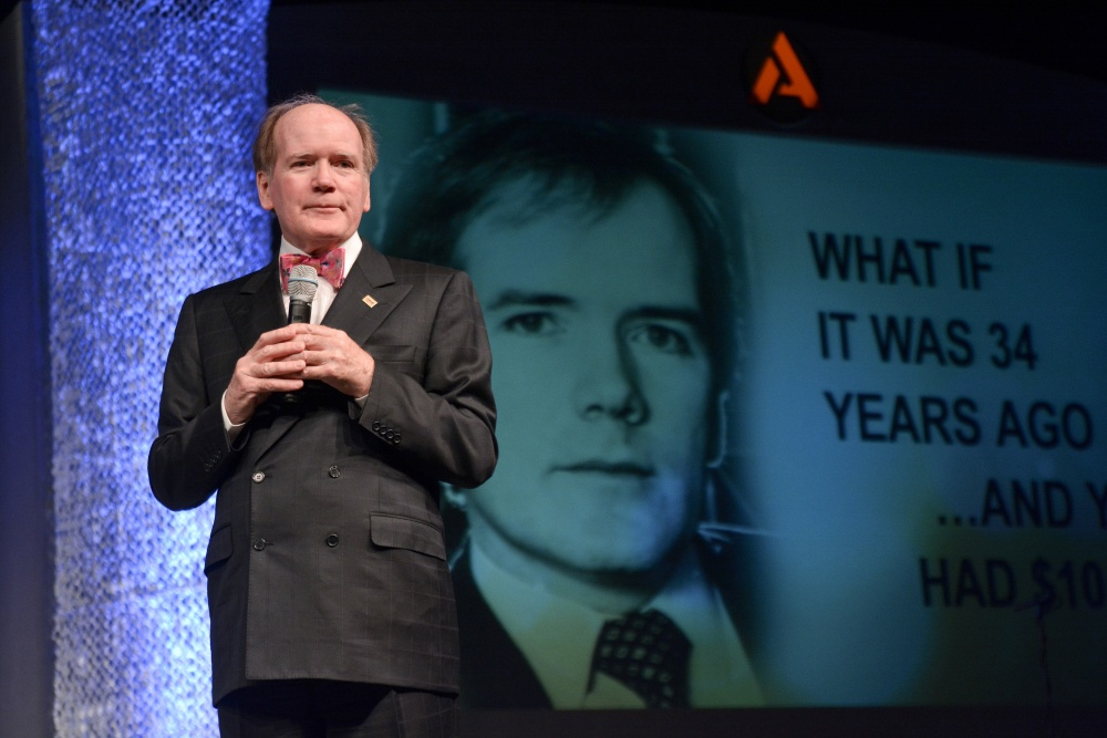 """Dr. Pearse Lyons, Alltech founder and president, addresses delegates and poses the question of """"What If?"""" during the opening plenary session at the 30th Annual Alltech International Symposium in Lexington."""