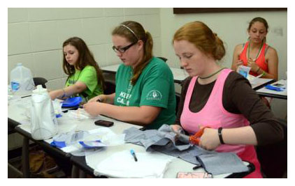 Photo by Katie Pratt From left, Sydney Agee of Montgomery County, Sarah Griffin of Oldham County and Bethany Reckart of Warren County make heel supports.