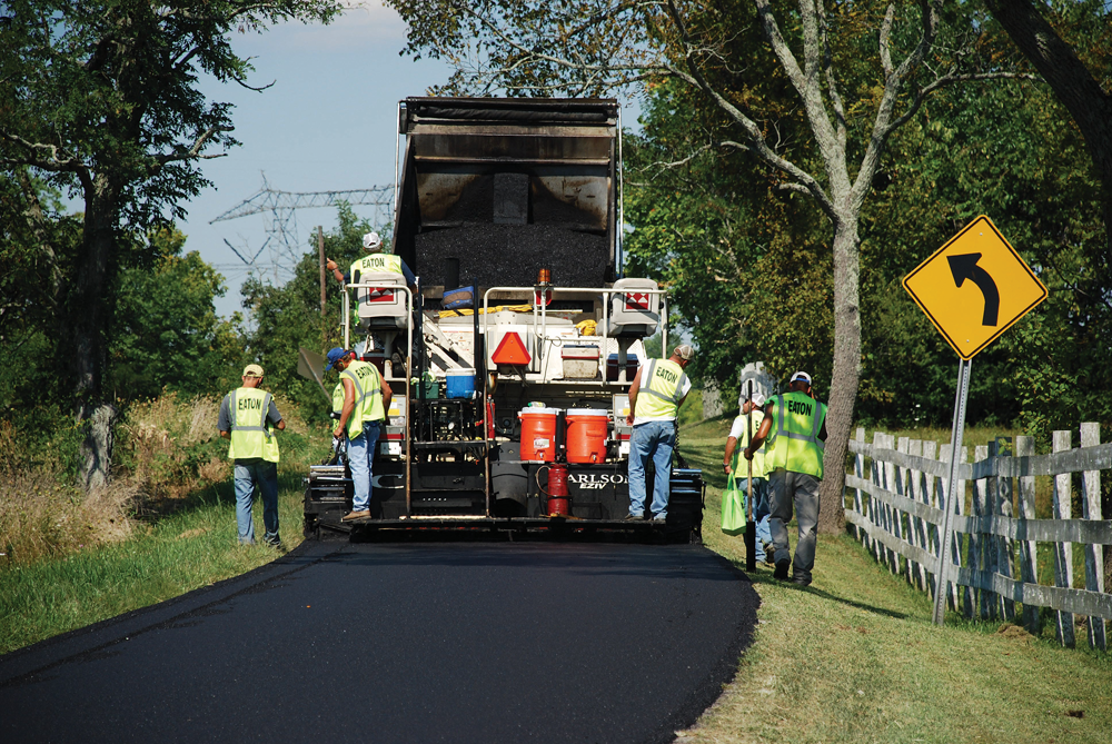 Workers from Eaton Asphalt Paving Co. of Fort Wright, Ky., pave Ky. Hwy. 195 in Grant County.