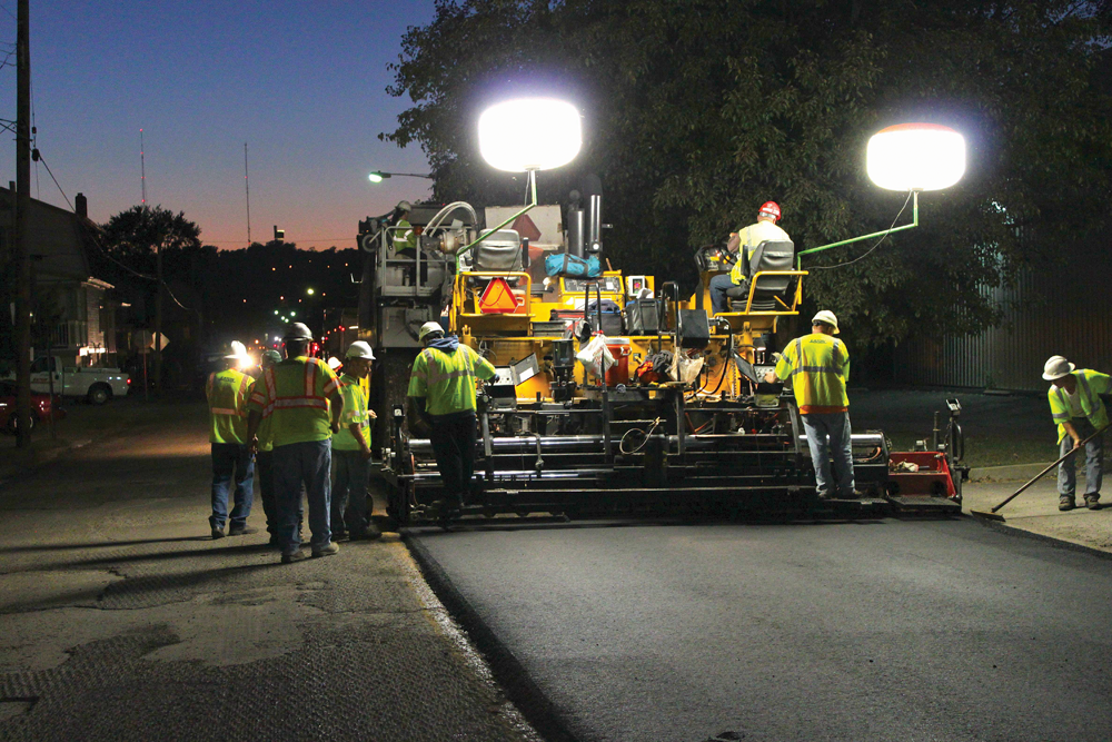 Eaton Asphalt Co. workers spend the evening paving Ky. Route 8 in Dayton, Ky.