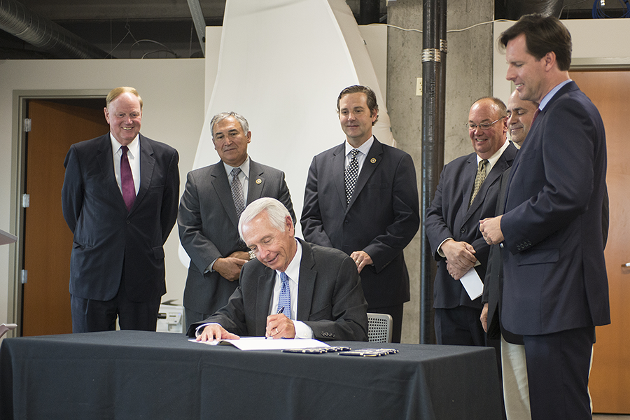 Gov. Steve Beshear signed two bills June 11 at The Nucleus.