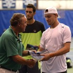 Kentucky Bank President Louis Prichard presents James Duckworth with the singles title in July.
