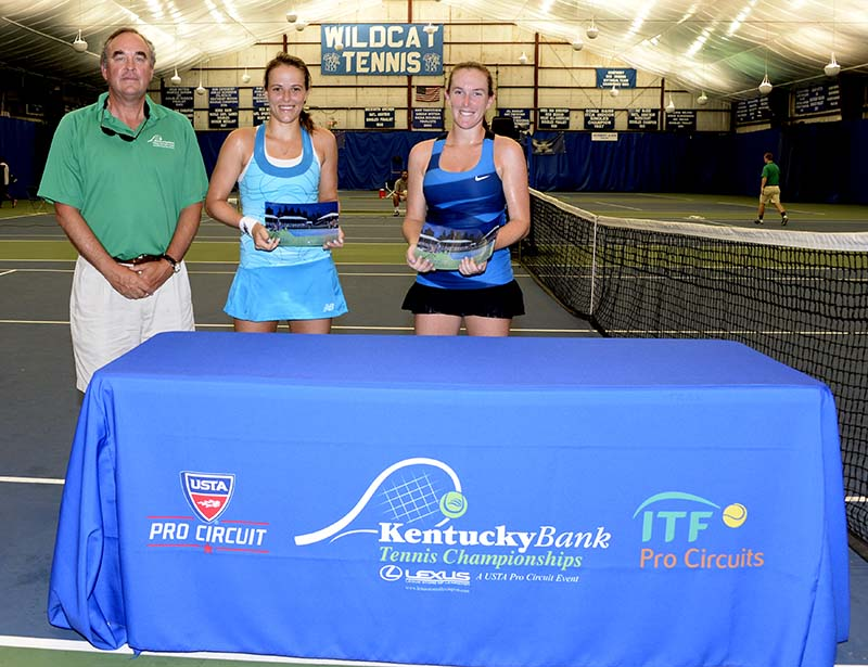 Kentucky Bank President Louis Prichard presents awards to Nicole Gibbs, finalist, and Madison Brengle, the winner of the women's singles final. (Photos by Charlie Baglan)