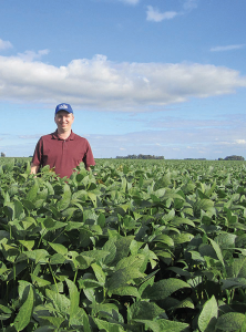 Chad Lee, professor in the University of Kentucky College of Agriculture, Food and Environment, stands in a Kentucky soybean field.