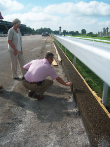 Keeneland Projects Administrator John Howard explains to Keeneland Director of Communications Amy Gregory the new Flexi-Pave drainage system that is being installed along with a new dirt racing surface.