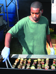 Kris Hale grills chicken kabobs for a booth in the Kentucky Proud Experience area at the Kentucky Exposition Center.