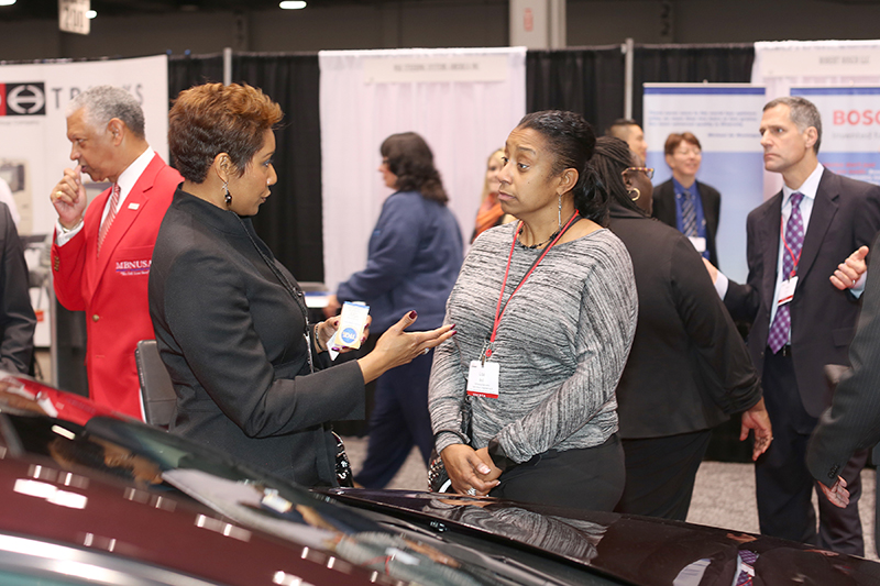 Tierra Kavanaugh Turner, left, speaks with Lisa Bell of Toyota Motor Engineering & Manufacturing North America at the Toyota Opportunity Exchange. Now in its 25th year, the Toyota Opportunity Exchange is set for Oct. 27-28 at the Duke Energy Convention Center in downtown Cincinnati.