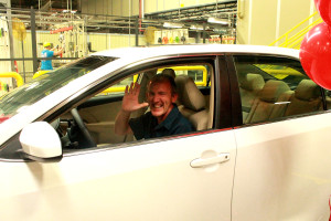 Tom Keith in the car he won.