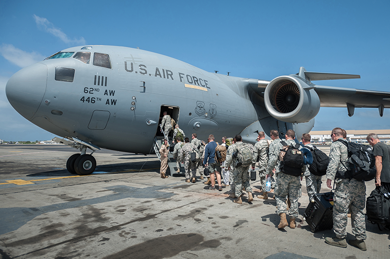 A group of 30 U.S. marines, airmen and soldiers with the Fort Campbell, Ky.-based 101st Airborne Division bound for Monrovia, Liberia, board a U.S. Air Force C-17 Globemaster III on Oct. 19 at Léopold Sédar Senghor International Airport in Dakar, Senegal. The U.S. troops will construct medical treatment units and train healthcare workers as part of the Operation United Assistance response to the Ebola outbreak in West Africa.
