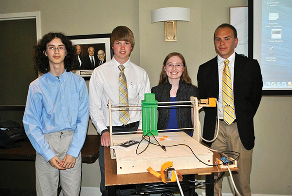 A student team from Edgewood, Ky., led by Matt Tarka, right, came to GSE 2014 to advance their plans to commercialize a small computer-numeric-controlled machine tool that can make precision cuts.