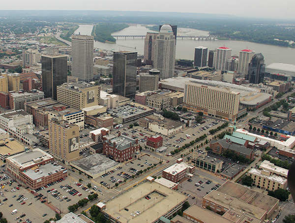 """The Louisville central business district experienced an """"explosion"""" of activity in 2014, according to an office market report by DTZ Harry K. Moore Commercial Real Estate. The growing global popularity of the Kentucky bourbon industry is being given credit for stimulating downtown development."""