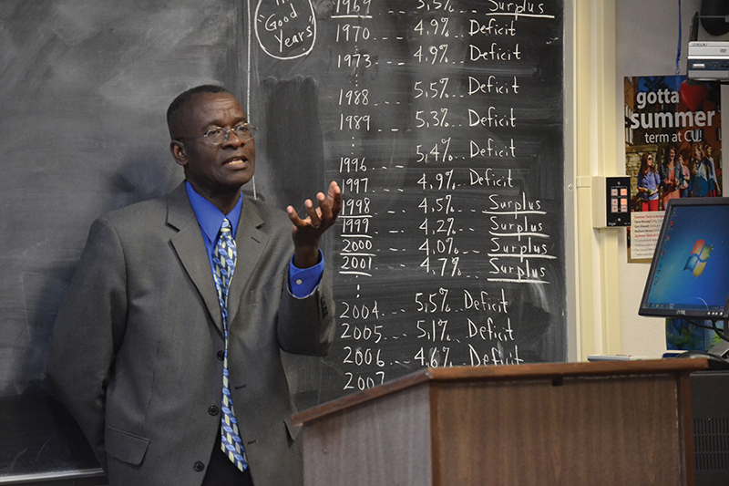 Sunny Onyiri, professor of business and accounting at Campbellsville University, teaches an MBA class.