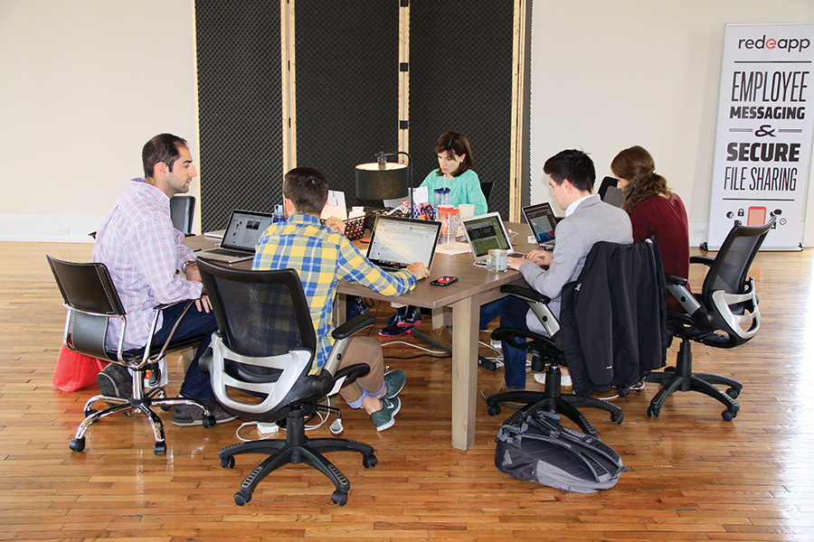 Red e App employees collaborate on the company's private business communication tool, which operates on mobile devices to provide work messaging and file sharing for companies with workers who do not have or regularly use an office work station. Companies using Red e App include manufacturers, restaurants, hair salons and transportation services.