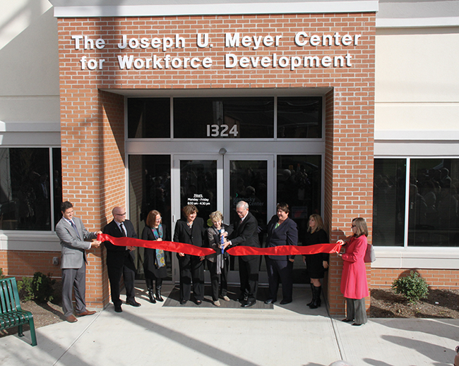 Local officials open the Joseph U. Meyer Center for Workforce Development on Madison Avenue in Covington on Nov. 7, 2014, one week before Boone, Campbell and Kenton counties were jointly certified as a Kentucky Work Ready Community. Operating previously at a different location as the Kentucky Career Center, in 2013-14 it made 5,300 outreach contacts to businesses, posted 5,766 jobs for employers, provided career training to more than 500 people, and helped 21,133 job-seekers obtain 12,452 jobs with an average wage increase of $16,929.