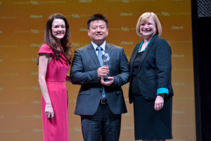 Dr. Aoife Lyons (left), director of educational initiatives at Alltech, and Dr. Inge Russell (right), director of the Alltech Young Scientist program, present Xiaoqiu (Churchill) Wang with his award as the graduate winner of the 10th annual Alltech Young Scientist program. Wang is a student at Texas A&M University.
