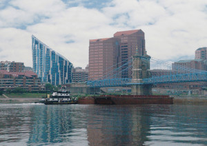 A tug pushes freight barges under the Roebling Bridge linking Covington and Cincinnati. The U.S. Army Corps of Engineers recently rededicated 226 miles  of the Ohio River as the Ports of Cincinnati and Northern Kentucky, which becomes the second largest inland port in the United States by freight tonnage.