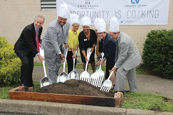 To help budding food service entrepreneurs operate their fledgling businesses legally in Louisville, Community Ventures partnered with the city health department to open the Chef Space Kitchen incubator downtown. Pictured during the June 29 groundbreaking are, from left, Louisville Metro Mayor Greg Fischer, Louisville Metro Council President David Tandy, Federal Reserve Bank Regional Executive Maria Hampton, Chef Space President Johnetta Roberts, Community Ventures President and CEO Kevin Smith, Susan Barry of the Community Foundation of Louisville and U.S. Congressman John Yarmuth.