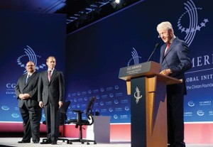 Former President Bill Clinton, right, announces the innovative STEM-TEK initiative during the Clinton Global Initiative America conference in Denver on June 10. At left, Tony Campbell, president & CEO of East Kentucky Power Cooperative, and Vince Bertram, president & CEO of Project Lead The Way, look on.
