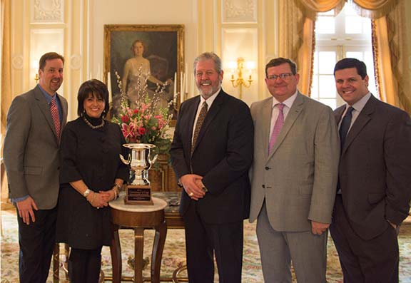 Many power utilities play very active roles in economic development recruiting in their service areas, not only to grow their business but to more efficiently manage their demand loads. After Kentucky received the 2014 Governor's Cup from Site Selection magazine for the number and size of projects it had, among those who attended a reception at the Governor's Mansion to celebrate were, from left, Brad Thomas, associate manager of economic development for East Kentucky Power Cooperative; and Lisa Payne, lead economic development manager Louisville Gas & Electric and Kentucky Utilities. Pictured with them are Bruce Carpenter, executive director of Corbin Economic Development Agency; Hal Goode, president/CEO of Kentucky Association of Economic development; and John Bevington, deputy commissioner of the Cabinet for Economic Development.