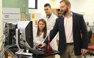 University of Pikeville assistant professor of chemistry Benjamin Clayton works with students Molly Frank of Greensburg and Wesley Barnett of Cynthiana, who are members of a team developing an organic feed additive for the poultry industry made from bloodroot grown in Eastern Kentucky.