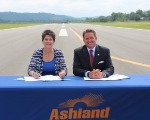 Ashland Community and Technical College President Kay Adkins and Eastern Kentucky University President Michael Benson at the signing, which was held on the Ashland Regional Airport runway.