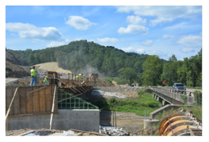 Crews working on a bridge across the Middle Fork of the Licking River in Magoffin County.