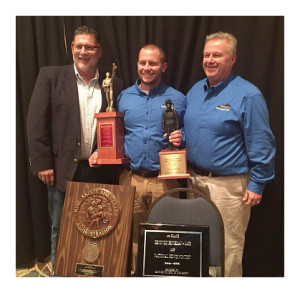 Taber Tichenor, Kentucky Coal Academy Mine Rescue team member, accepts the 2015 National Mining Association Mine Rescue Bench Biopak Award from Ted Beck, Biomarine Inc. sales manager, and Danny Knott, KCA Mine Rescue director.