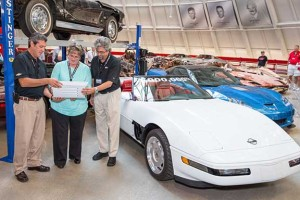 During the restoration of the 1-millionth Corvette, the 1992 Corvette damaged in the sinkhole disaster at the National Corvette Museum, Chevrolet found hundreds of workers' signatures on the vehicle from workers during its production at the Bowling Green Assembly plant. Chevrolet was able to save all of the signatures except for one - from retired General Motors employee Angela Lamb, who recreates her signature on a panel of the car before it is reattached - to complete the restoration process Thursday, September 3, 2015 at the National Corvette Museum in Bowling Green, Kentucky. GM Global Design Fabrication Operations Director David Bolognino (left) and Executive Director Global Chevrolet Design John Cafaro hold the panel for Lamb. (Photo by John F. Martin for Chevrolet)