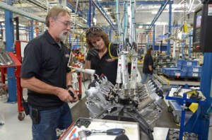 An Engine Builder performing an SIDI Check on a Corvette LT4 engine in the Performance Build Center