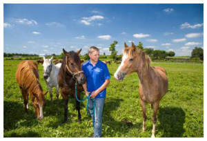 Martin Nielsen with horses at UK's Maine Chance farm.