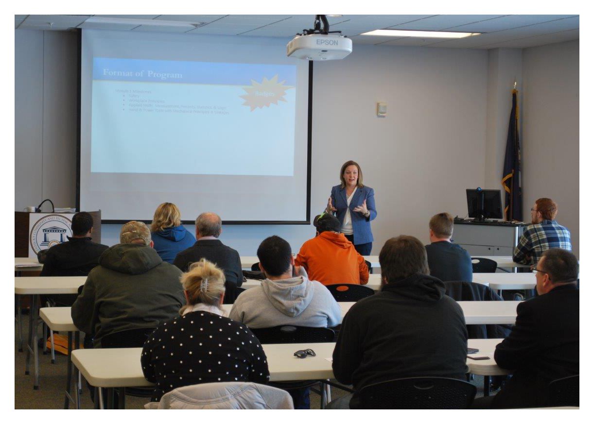 Angie Praisewater instructs new Enhanced Operator student