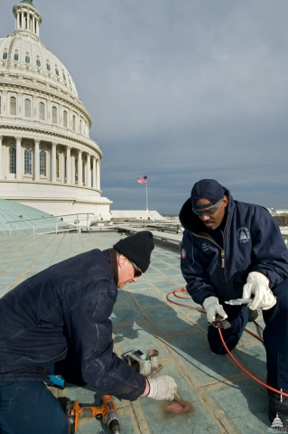 Helping to ensure the dome returns to its original splendor by the day of the next presidential inauguration ceremony is Project Manager and Capitol Jurisdiction Project Executive for the Architect of the Capitol Eugene Poole, a 1985 architecture graduate of the University of Kentucky and native of Hopkinsville, Kentucky. Poole (on the right) is seen here inspecting the dome. Photo courtesy of Architect of the Capitol.