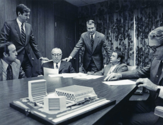 Jim Host, center, addresses and Lexington Center board meeting in the early 1970s as they discuss a preliminary design for Rupp Arena and the Lexington Convention Center complex.