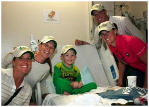 International riders (from left) Allie Knowles, Jessica Payne, Lauren Kieffer and Doug Payne brought a souvenir hat and other Rolex Kentucky Three-Day Event gifts to Lucas Turner, age 7, at the Kentucky Children's Hospital on Tuesday.