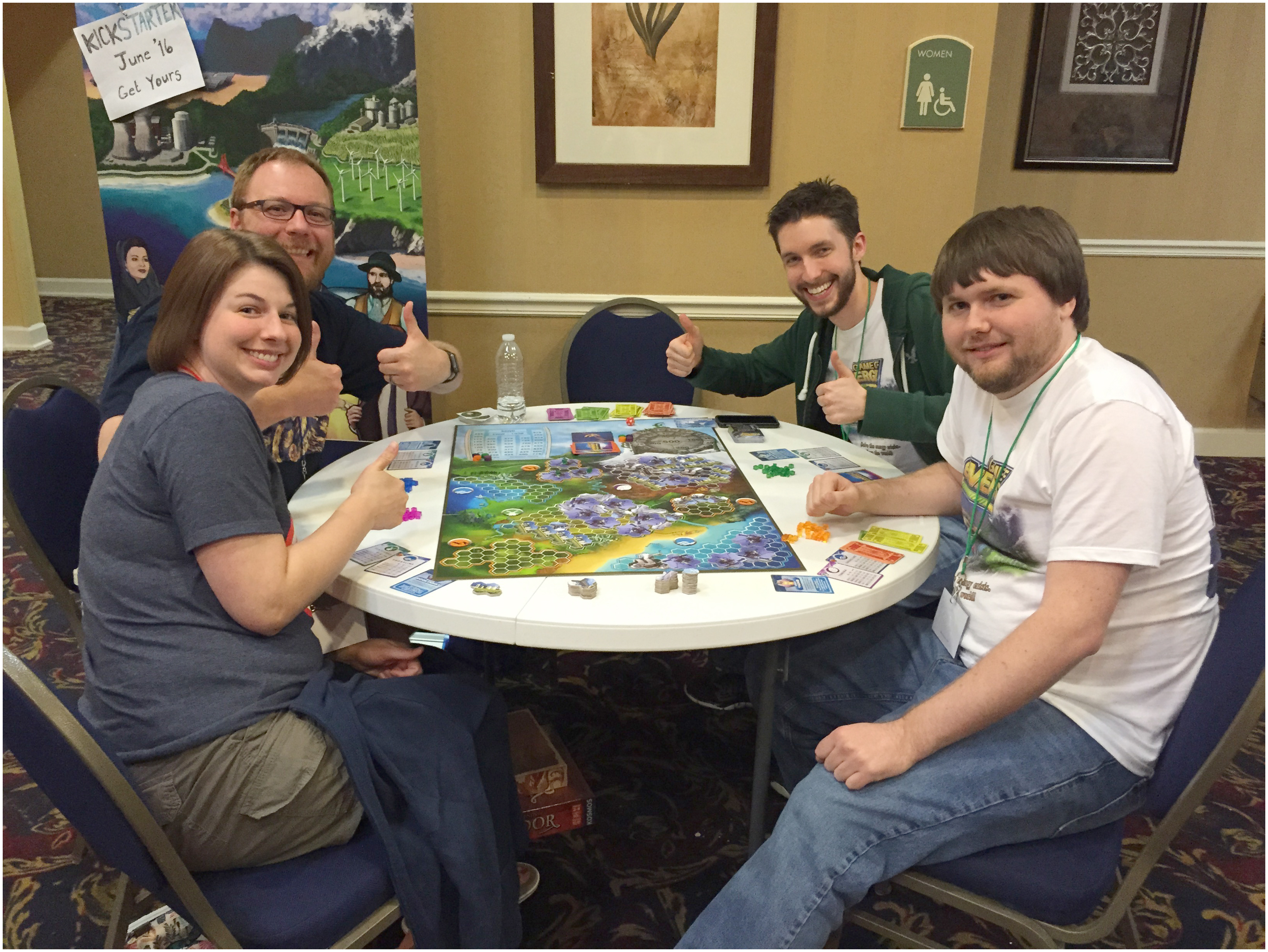 Wright (second from right) and group playing Game of Energy at gaming conference.