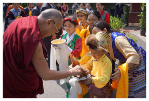 The Dalai Lama is offered a traditional Tibetan welcome on his arrival at the Drepung Gomang Institute in Louisville, on May 19 2013.