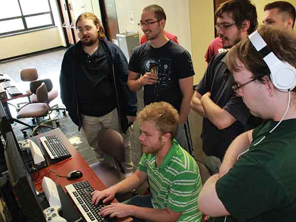 Students in the Eastern Kentucky University Gaming Institute interact in groups to program new video games.