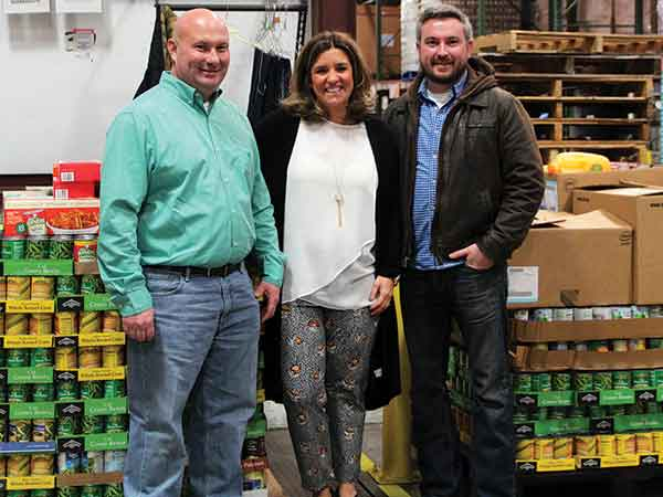 Agriculture Commissioner Ryan Quarles, right, and John Cook, executive director of the Kentucky Department of Agriculture's Office for Consumer and Environmental Protection, delivered donated foods to God's Pantry of Lexington and interim executive director Ame Sweetall on Dec. 28.