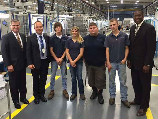 Dr. Schneider Automotive Systems in Russell Springs has a nationally recognized youth apprenticeship partnership that may be replicated across the state as part of the Kentucky Trained, Kentucky Built initiative. Pictured there in June are, from left, Education and Workforce Development Cabinet Secretary Hal Heiner, Plant Manager Torsten Langguth, Garrett Foley, Randa Ballenger, Tyler Moore, Dylan Bryant, and Labor Cabinet Secretary Derrick Ramsey.