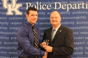 John Stanko, left, accepted the award of UK Police Officer of the Year from UK Police Chief Joe Monroe. Photo by Jesica Lopez-Huskey.