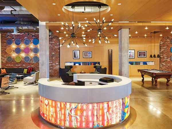 The front desk of the Aloft Hotel Louisville is stylish, but Steve Poe requires that his project designs above all fit the financial parameters that make it buildable.