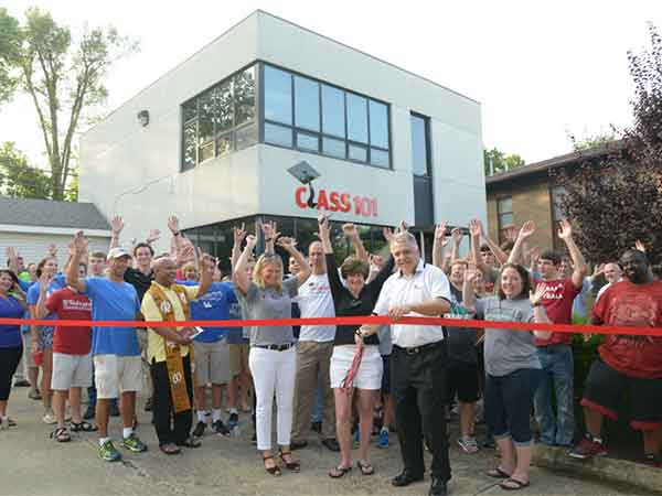 Class 101 Founder and CEO Tom Pabin cut ribbon recently during a celebration at the Lexington office.