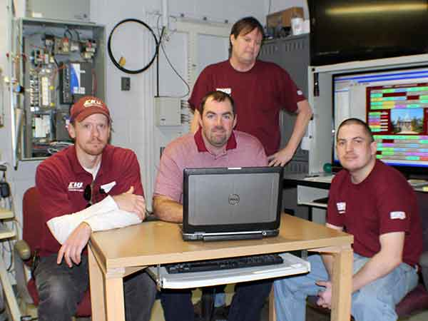 Members of EKU's energy management team include, (from left) Kent Chambers, Kyle Willis and Kyle Shultz, and, standing, Eddy Cress. (Photo by Randy Wilson)